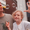 97/08/27-- bubble --Takaaki Iwabu photo--Bryan Boone, left, entertains his daughter Kayla, 5, by blowing bubbles as they sit on their porch on 12th and Ferry Ave. Monday. <br /> <br /> Grapevine photo