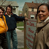 98/04/18--block club--Takaaki Iwabu photo-- Niagara Falls Neighborhood Housing Service, here represented by Annie Fields-Chapman, right, gives a grant to the area's six different block clubs for its activities.  Standing with a new sign on 27th and Independence Ave. are, from left, Roger Spurback, president of Home Neighborhood Association, and Joe Monaco, vice president of Niagara Falls Block Club Council.      GRAPEVINE Photo