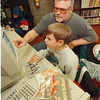 3/22/97 Reading Help - James Neiss Photo - Kragh  Marshall (sq on spelling) 7yrs, 1st grade at 60th Street School works on a reading program on a computer at the Niagara Falls Library with help from his dad Kevin Marshall. 285-5452<br /> <br /> Outlook 97