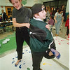 1/28/97 Science & Math Night - James Neiss Photo - NickZucco 10yrs/5th grade and mom Judy Zucco left their foot prints as part of a math problem to estimate the number of footprints left at the end of the night.<br /> LewPort North Elementary School<br /> Schools