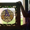 98/04/21 Stain Glass-Rachel naber Photo-jason Hucknall, 10th grader at orleans county Nursing home with the project the Albion High School students made with V.P. Kinney.