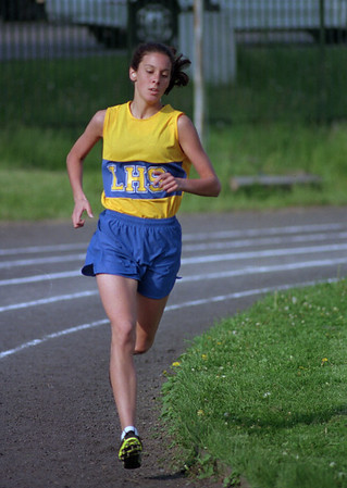 98/05/07 Won Easily *Dennis Stierer Photo - Erin Mullaney easily won the girls 1500 meter event.