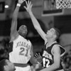 1/2/97--HOOPS/B&W--CAPPY PHOTO--NU'S CHRIS WATSON BATTLES WITH LEHIGH'S  ALAN FERGUSON IN SECOND THIRD QUARTER ACTION