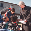 "4/2/97-- healthy program-- Takaaki Iwabu photo-- Gail Marie Root, right, of Niagara County Health Department, talks to Crayuana and Crayshanda Paige at Jordan Gardens as the babies' cousin Michelle Taylor watches. The door-to-door survey  ""Healthy Neighborhood Program"" starts Thursday at this housing complex."