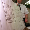 98/12/07 Medina BLdg-Rachel naber Photo- Dr. Leopardi displays plans for the new building at Medina Central Schools.