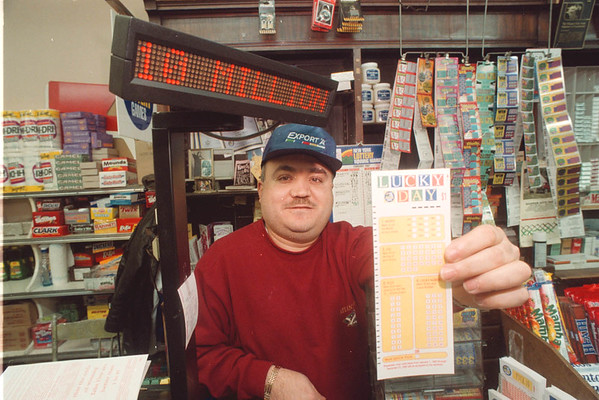 "2/14/97 Lucky Day Lottery - James Neiss Photo - Freddie Mansour, owner of ""Mario's Novelty"" on pine ave., a popular lottery purchasing location, shows off the new Lucky Day lottery form."