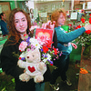 2/13/97 Valentines Day Preperation - James Neiss Photo - Falls Green House, Sheryl Glenn and Yvette Daniels, floral Designers for Falls Greenhouse, work on Valentines Day Arrangemnets. Shery's Arrangment even has a CD of Love Songs.