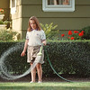 7/11/97- swirling water -Takaaki Iwabu photo-- A 8-year old Charisse Coleman of Niagara Falls, Ontario, swirls a hose when she puts water in front of her aunt's house on 30th Street Friday. (She crossed the border to visit her aunt in NF, US. )
