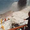 4/23/97 Cave of Winds Damage 2 - James Neiss Photo - Bob Kesil, Cave of the Winds Facility Manager , supervises snow removal from areas where the wooden decking is to be built. The men are using water from the falls to melt the snow and Ice.<br /> <br /> Cave of the Winds Tour Ice Damage