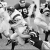 98/10/03 Newfane Football  #3  *Dennis Stierer Photo -<br /> Newfane's #80 goes for the tackle on Maryvales' #44 (I think)