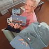 97/09/18 Jeanne Torre - James Neiss Photo - Jeanne Torre of NF shows off some of her vacation photos and souvenirs. <br /> <br /> Judy K.  feature story.
