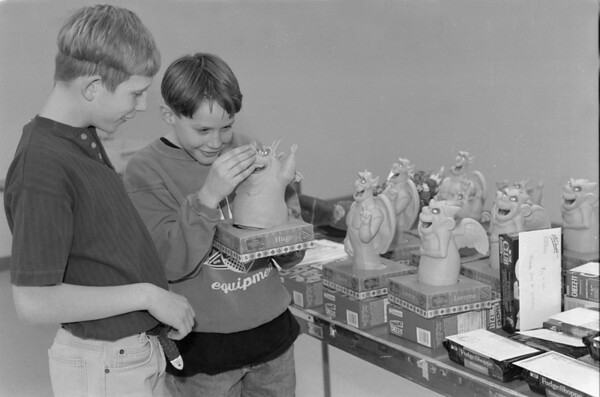 """98/02/21 Ridgeway Fundraiser *Dennis Stierer photo - Chris Standish, 12 and Robert Snow,11 check out """"Hugo"""" one of the auction items."""