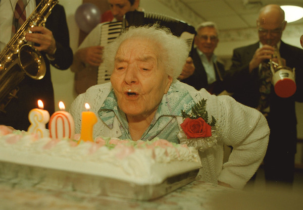 """98/02/21-- granny --Takaaki Iwabu photo-- Luigina Silvestrone, 103, blows out the candles on the birthday cake as the band plays """"Happy Birthday"""" at Northgate Manor Nursing Home in North Tonawanda Saturday. <br /> <br /> local, Sunday"""