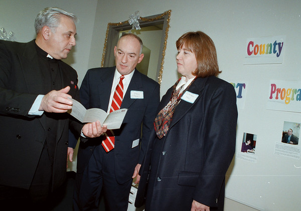 98/12/04 catholic charities--dan cappellazzo photo--(ltor) msg. henry J Gugino, dioscosin dir of c.c. talks about the 70th anniversary of cc to judge paul crapsi and mc dist dir of cc kathleen hall.