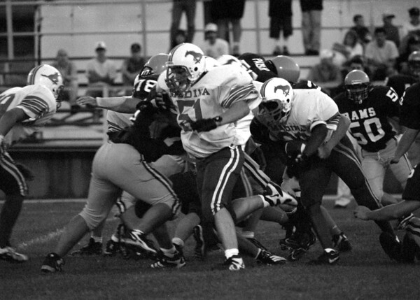 98/09/05 Medina Football *Dennis Stierer Photo -<br /> Medina's #51 gives some blocking room for #33 to run through during 1st quarter play.