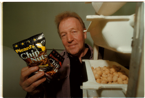 "97/11/13 Chip Nuts - James Neiss Photo -James Picard, President of ""Picard Peanuts LTD."" Shows off some of his product at his Niagara Falls Manufacturing Plant."