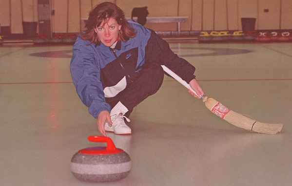 3/16/97--CURLER--DAN CAPPELLAZZO PHOTO--U.S. NATIONAL CURLING TEAM MEMBER PATTI LANK, OF LEWSITON LETS THE STONE FLY DURING PRACTICE IN N.F. ONT.<br /> <br /> ECHO