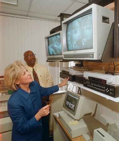 97/09/26 Lasalle Servalenece2 - James Neiss Photo - LaSalle Principal Judy Warren and Ast. Principal Manning Fogan watch activities on the new school wide video monitoring station.