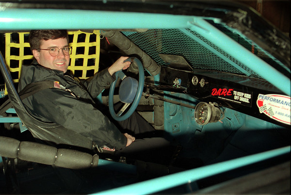 98/02/19 Beakman Racing *Dennis Stierer photo - Paul Beakman checks out the drivers seat of his latest dirt stock racer.