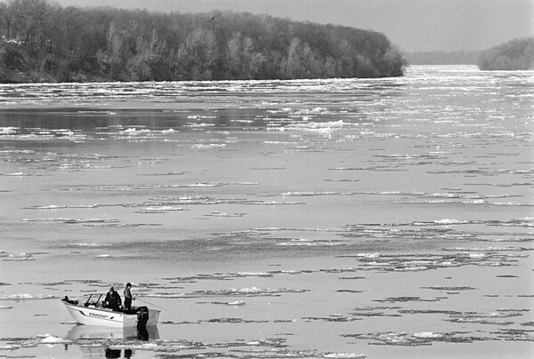 1/21/97 Icy Fishing - James Neiss Photo - Two fisherman try to get the big one in a ice filled Niagara River off Lewiston Landing.