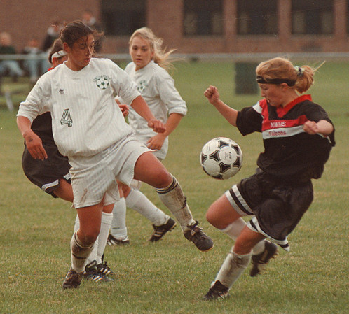 97/10/02--GIRLS SOCCER--DAN CAPPELLAZZO PHOTO--LEWPORT STRIKER ROSIE LUZAK (WHITE) BATTLES WITH N.W.'S KIM HOYT IN SECOND HALF ACTION AT LEWPORT HIGH.<br /> <br /> SP