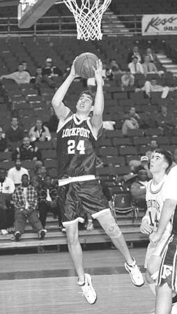 2/27/97--SECT 6 HOOPS B&W--DAN CAPPELLAZZO PHOTO--LOCKPORTS CHARLES CROFF GOES UP IN THE PAINT.<br /> <br /> SP