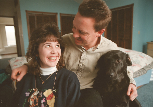 "98/01/04--Recovery 2-- Takaaki Iwabu photo-- Kelly, his husband Jamie O'Donnell and their dog ""Taz"" at their home in Wilson. <br /> <br /> living, Sunday, color"