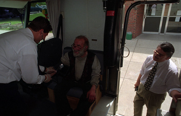5/28/97--CATHOLIC WORKER/HEALTH--DAN CAPPELLAZZO PHOTO--SERVICE COOR. CHRISTOPHER KOCHAN TAKES THE BLOOD PRESSURE OF NF RESIDENT ARNOLD BROOKS, AS ADM. DIR. COMMUNTIY MENTAL HEALTH CARLOS REYER LOOKS IN  TO THE MEMORIAL MEDICAL CENTER MOBLIE HEALTH UNIT PARKED IN FRONT OF THE CATHOLIC WORKER, ON NIAGARA STREET. THE UNIT CHECK OUT OVER 100 AREA POEPLE WEDNESDAY.<br /> <br /> GRAPE