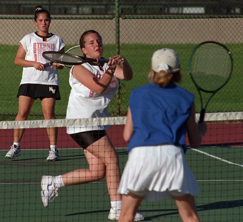 97/10/06--TENNIS B&W--DAN CAPPELLAZZO PHOTO--NW DOUBLES TEAM JENNIFER STEDGE (FRONT, WHITE) AND MISTY SNOPKOWSKI RETURN VOLLY AS GI'S JEN BULLOCK GUARDS THE NET AT NW HIGH.<br /> <br /> SP