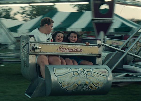 "7/10/97 fun fest 2--Takaaki Iwabu photo-- From left, Sue Beningo, Ryan Lagace and Alexis Willard share the excitement of ""Scrambler"" ride at Fun Festival in Niagara Catholic High School Thursday. <br /> <br /> Grapevine photo"
