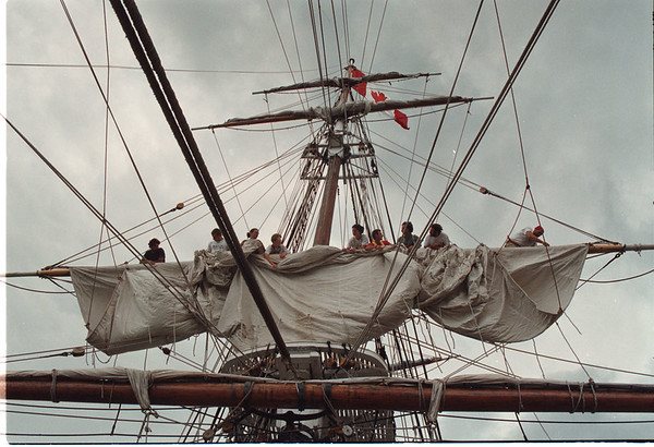 7/3/97 HMS Bounty 5 - James Neiss Photo - Deck hands were re-furling a sail after docking in lewiston.