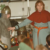 98/02/17--MIDEVIL DAYS/CONNOR MIDDLE--DAN CAPPELLAZZO PHOTO--MIDEVIL STORYTELLER LORNA CZARNOTA, DRESSED AS A PESANT, POINT OUT THE STEEL MEST ON CONNOR MIDDLE SCHOOL  6TH GRADER STUDENT MICHAEL COZZENS. THE STUDENTS ARE LEARNING ABOUT THE MIDDDLE AGES ALL WEEK.<br /> <br /> LOCAL THURSDAY