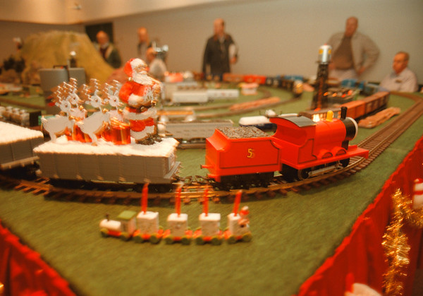 98/12/05 Train Show - Vino Wong Photo - A miniature Santa Claus gets a ride during the Toy Train Collectors Society annual show at the Convention and Civic Center Saturday.