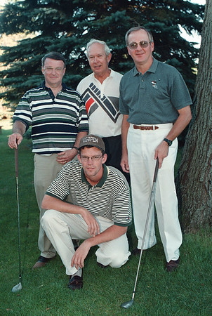 8/18/97-- Golf Tourney 2--Takaaki Iwabu photo-- A team winner of Pro-Am Golf Classic. Kneeling is Eric McHone (pro). Standing, from left, Brian O'Donnell, Fran Baumler and Gerald Tucker. (Paul Eckert, another player for the team, is not shown in the Photo)
