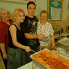 98/05/19--pasta dinner --Takaaki Iwabu photo-- Lew-Port International Siblings hosted pasta dinner to raise a fund to send students to Japan this summer. From left, Linda Gerlach, Lew-Port High School teacher, Tanis Winslow and Mark Gerlach, both 10th-grader, and Evelyn Perkins, advisor for the trip.  Winslow and Gerlach are two of several students who will make a trip.     ECHO MIRROR Photo