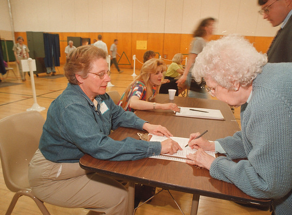 5/28/97 LewPort Vote - James Neiss Photo - Mona Sweeney, a election Volunteer, signs up Stella Bak of Ransomville.