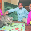 1/23/97--family picture 2 --tak photo-- Shayla, Kendric and Kristin play together with their house cat............... (Judy might know her name.)