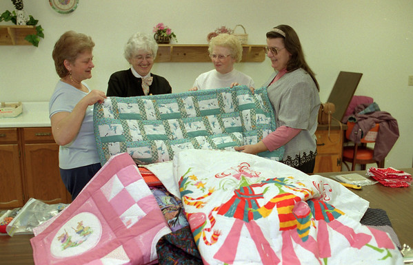 98/03/04 Quilting Seniors *Dennis Stierer photo - From Left are:  Sue Forsyth;  Alice Thomas;  Helen Fura;  and Barb Johnston.