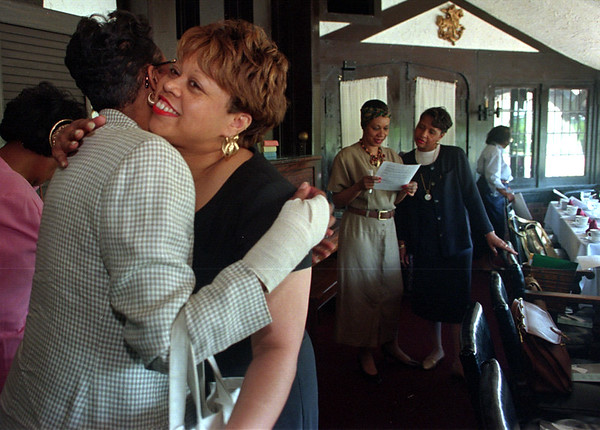 6/14/97--Links--Takaaki Iwabu photo-- Elizabeth Bradley, left, gets a hug from another member of Links during the group's meeting Saturday. (They celebrate The Day of the African Child Saturday) <br /> <br /> 1A, Monday, color