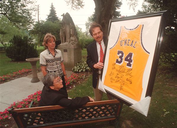 """97/09/17 The Key Event - James Neiss Photo - Standing, Joanne and Jim McClincy, Co-Chairs of """"The Key Event""""  and ,sitting, Sister Nicholas Macoretta, Director of Education at Stella Niagara all show off a O'Neal jersey up for auction at the event."""