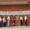 7/14/97--OLDE NIAGARA DAYS--DAN CAPPELLAZZO PHOTO--MEMBERS OF THE NIAGARA FIRE CO. #1 HANG A SIGN FOR THE EVENT. SEE ATTACHED SHEET FOR IDS.L