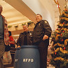 98/12/11 Blue Barrel - Vino Wong Photo - Pastor Stephan Booze shares a light moment with officers Sal Palnessa and Tony Catalano during the kick-off of the Blue Barrel food drive at Tops on Portage Road Friday.