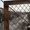98/02/18- hazard --Takaaki Iwabu photo-- President Myles, onwer of Auto Reclaim Scrap Cetner Inc. on 5501 Lockport Rd., walks by the gate of his junk yard. (For Hale's story on on-going enviromental problem in the area.... ) <br /> <br /> local, bw, Thursday