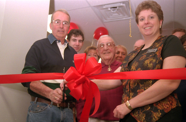 98/11/07 Wilson Farm-Rachel naber Photo- Jerry Dean (left) Mayor of wilson, Ray Jones (middle/Red shirt) grandfather to Leann Haley (right) cut a ribbon for grand opening of Pharmacy in Wilson.