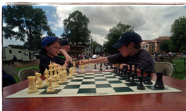 97/09/13 Gluck Park Rededication - James Neiss Photo - Timmy Grossman 5yrs of Lewiston, Garrett Szpila 13 of NF and Nicholas Soto 12 of NF play chess outside at the Gluck Park Rededication.