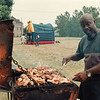 7/26/97-- eastside fest--Takaaki Iwabu photo-- Ricky Reynolds grills chicken at annual Eastside Festival on East Falls St. Saturday. <br /> <br /> grapevine