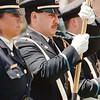 5/12/97--POLICE MEMORIAL--DAN CAPPELLAZZO PHOTO--NF PATROLMAN AND COLOR GUARD PAUL NICASTRO STANDS AT ATTENTION DURING A CEREMONY AT VETERNS PARK  HONORING OFFICERS WHO DIED IN THE LINE OF DUTY.<br /> <br /> 1A NEWS