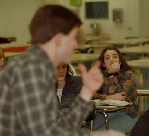 97/11/21--SCHOOLS/LASALLE--DAN CAPPELLAZZO PHOTO--LASALLE FRESHMAN ANGELA MOGAVERO LISTENS AS 9TH GR. EARTH SCIENCE TEACHER ED MAYNARD TALKS TO HIS CLASS ABOUT THE NEW SCHOOL THEY WILL ATTEND WHEN THEY ARE JR'S IN TWO YEARS.<br /> <br /> 1A
