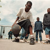 5/23/97-- dribbling --Takaaki Iwabu photo-- Michael Maye, 13, shows off his dribbling technique as he plays with his friends at Unity Park Friday. <br /> <br /> Grapevine photo