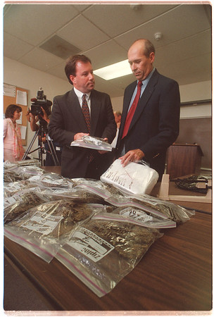 97/08/25 Drug Bust - James Neiss Photo - William M. Flynn, First Deputy Attorney General and Niagara County Sherif Thomas Beilein look over the 75lbs of seized Marijuana.<br /> <br /> See Release...